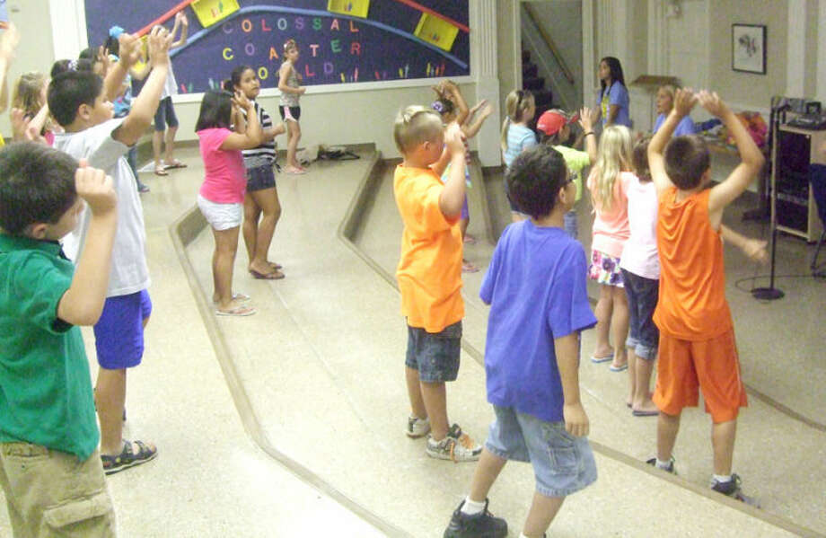 Third graders at First Baptist Church's Vacation Bible School learn moves to the theme song for the week. There were 280 kids on Monday. Photo: Jessica Thornton/Plainview Herald