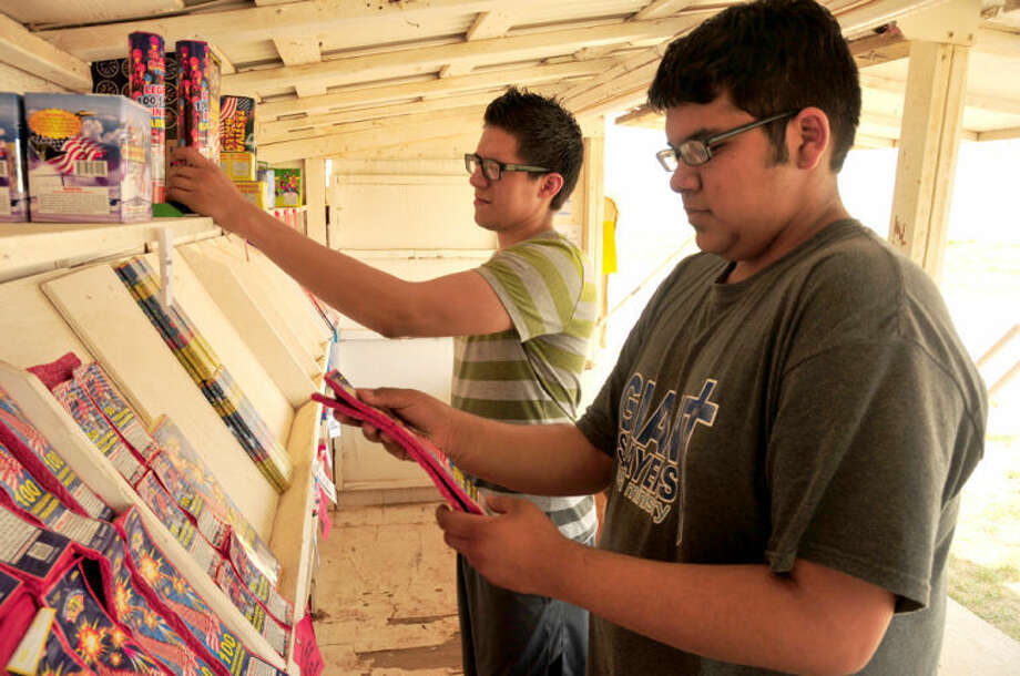 Jonah Reyes (front) and Steven Martinez stock up on fireworks as Monday marked the first day to sell fireworks in Hale County. Local stands will sell up to the end of Independence Day. Photo: Homer Marquez/Plainview Herald