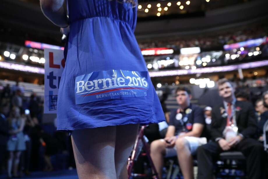 PHILADELPHIA, PA - JULY 25:  An attendee in support of Sen. Bernie Sanders walkst he floor on the first day of the Democratic National Convention at the Wells Fargo Center, July 25, 2016 in Philadelphia, Pennsylvania. An estimated 50,000 people are expected in Philadelphia, including hundreds of protesters and members of the media. The four-day Democratic National Convention kicked off July 25.  (Photo by Chip Somodevilla/Getty Images) Photo: Chip Somodevilla, Getty Images