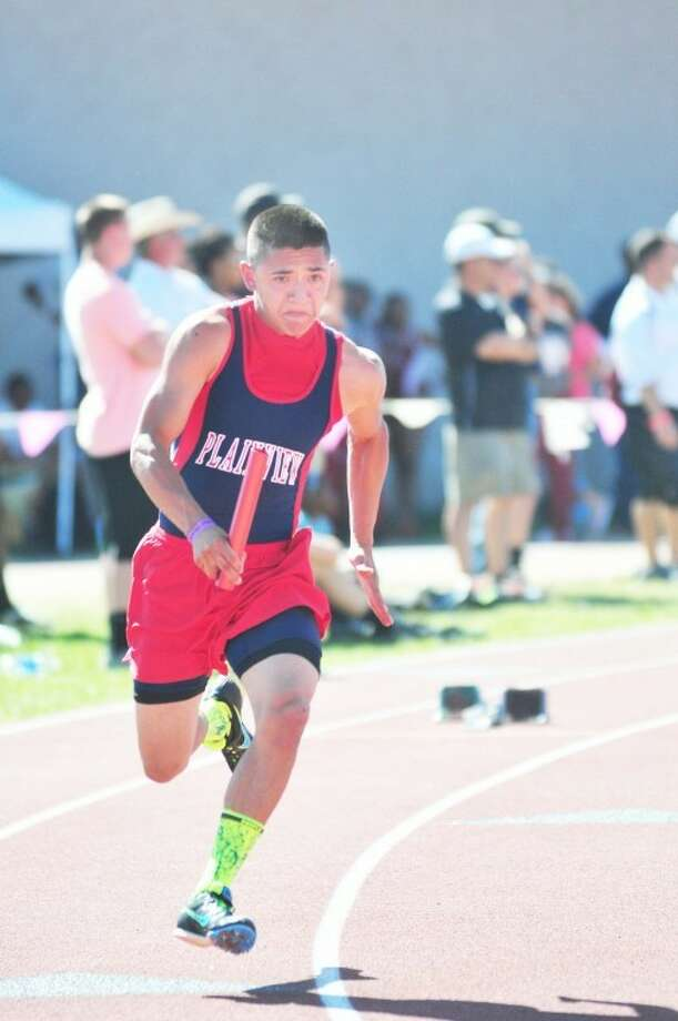Plainview's Ruben Lopez starts the sprint relay at the regional meet in Abilene. (Pick up a copy of the Herald for more photos!)