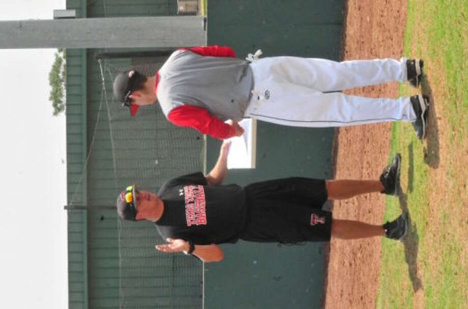 Joe Hughes (left), director of baseball operations at Texas Tech University, talks with Joshua Shedd of Levelland at the Complete Showcase for high school baseball players at David and Myrt Wilder Field Tuesday afternoon. Shedd, who will be a senior second baseman on the Levelland baseball team next year, was one of 90 high school players who took part in the camp. Players were evaluated by 19 college coaches who then talked with each player one-on-one about how they can improve their skills.  Photo: Skip Leon/Plainview Herald