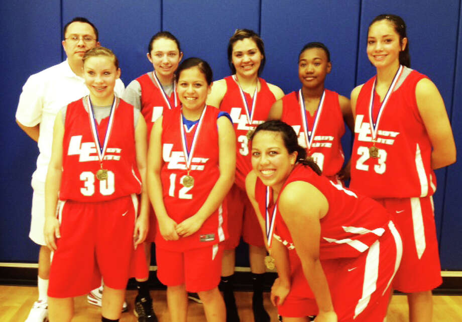 Lady Elite Varsity was crowned champions at the Southwest Hoops Classic held April 20 and 21 in Lubbock. The team lost to Estacado One Way 38-36 before winning its next three games, including beating One Way 52-46. Members are (front, from left): Jaden Gonzales, Stormie De La Garza, Stacey De La Garza (back) head coach Jeff Gonzales, Taylor Garza, Jasslyn Portillo, Markeyla Hicks and Karli Wheeler.