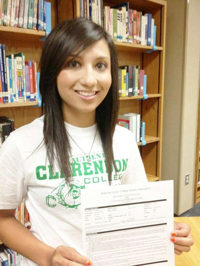 Courtesy PhotoPoint guard Amissa Reyna of Lockney shows the agreement she signed to play basketball at Clarendon College.
