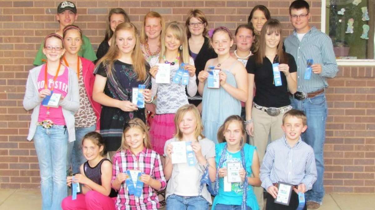 Courtesy PhotoHale County 4-H members shown with awards received at the County Round-Up are Keleigh Pitcock (front row, left), Kate Johnson, Kira Pierce, Cierra Burt, Ryan Walden, Colti Wright (middle, left), Sterling Skinner, Layne Mustian, Kennady Johnson, Zoey Burt, Emily White, Kristen True, Kelton Skinner (back, left), Sarah Berry, Samantha Sullivan, Shayla Perry, Letti Cheyne and Logan Mustian. Not pictured are Megyn Shadden and Carly Taubert.