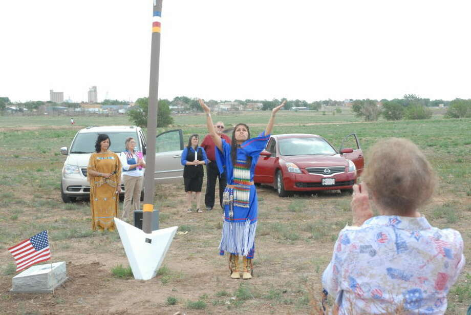 Victoria Paz, great-great-great-granddaughter of Chief Quanah Parker, performs the Lord's Prayer on Thursday during the blessing of the 22-foot arrow erected at the Plainview Point Kill Site. Photo: Homer Marquez/Plainview Herald