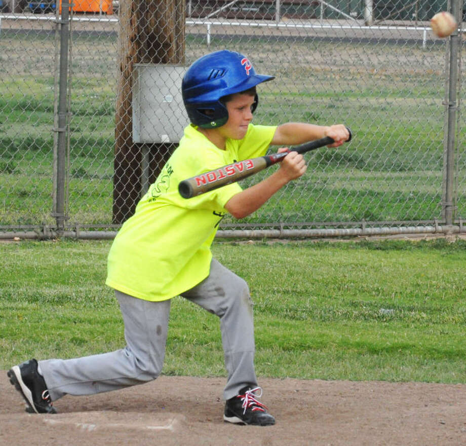 Austin Hauk of the Plainview 10-year-old all-star team bunts the ball during practice earlier this week. The 10-year-old all-stars begin state tournament play at 8 p.m. today in Muleshoe against Morton. Photo: Skip Leon/Plainview Herald
