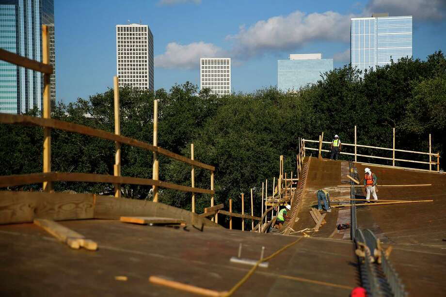 Construction crews work on the roof of a performance pavilion in Levy Park, a nearly six-acre piece of land in the Upper Kirby District, Friday, July 22, 2016. The public park is expected to be partially open by October. ( Michael Ciaglo / Houston Chronicle ) Photo: Michael Ciaglo, Staff / © 2016  Houston Chronicle
