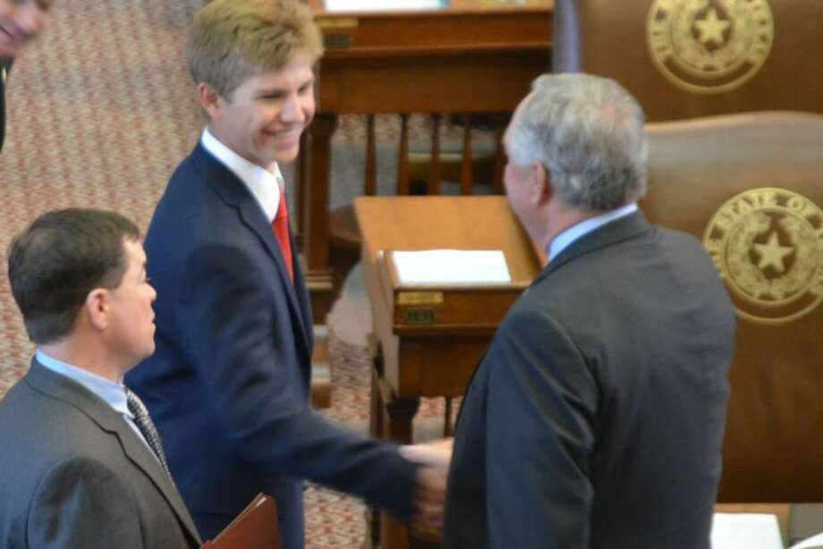 State Rep. Ken King (left) introduces Brock Walker to a fellow House member while the Plainview High junior was serving as an honorary sergeant-at-arms during the 83rd Legislature. Walker is the son of Kevin and LindaGail Walker. Photo: Texas House Of Representatives Photo
