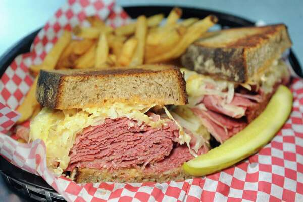 Classic Reuben has house-made corned beef, saurkraut, smoked Swiss and Russian dressing on rye with fries and a pickle on Thursday, July 14, 2016, at Chester's Smokehouse in Troy, N.Y. (Cindy Schultz / Times Union)