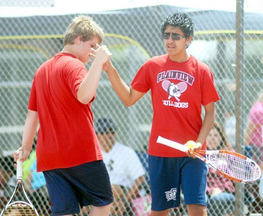 The Plainview doubles team of Wiley Hawkins (left) and Victor Vega celebrate a point at the District 3-4A Jr. High Tennis Tournament here Saturday. Hawkins and Vega took fourth in boys A doubles, while the girls doubles duo of Aris Samarripa and Angelica Sena was fourth in girls A doubles. Photo: Kevin Lewis/Plainview Herald