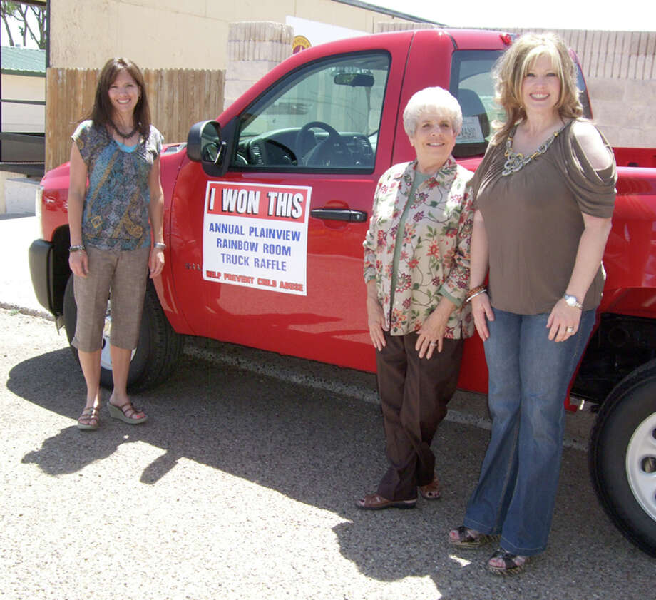 Nicki Bruce Logan/Plainview HeraldMyrt (center) and David Wilder, owners of P&E Leasing, won the 2012 Chevrolet pickup that was raffled by the Community Partners of the South Plains to benefit its Rainbow Room, a resource for CPS caseworkers providing for abused and neglected children in a seven-county area. The ticket was drawn during Wednesday's annual Lions Club/Rainbow Room luncheon at Plainview Country Club. Ashley Mayberry (left) and Shanna Pritchard represent the Rainbow Room.