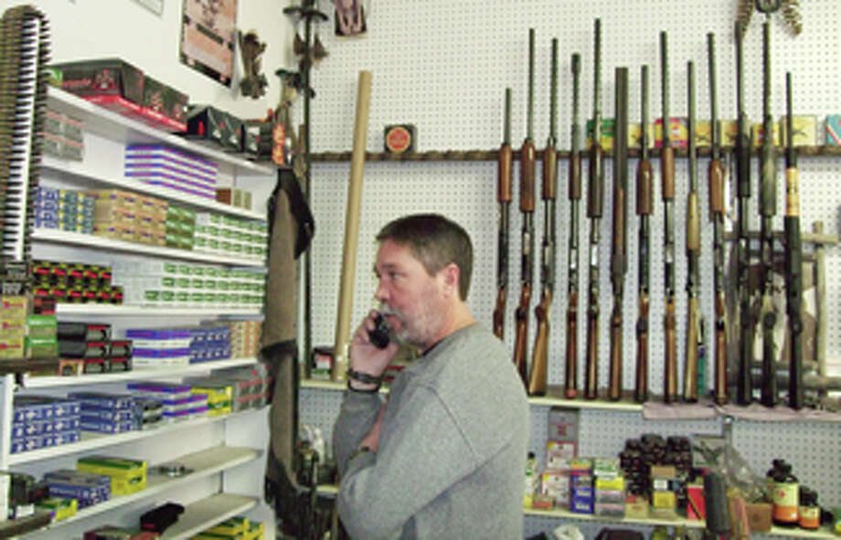 Rick Morton of Hubbard Jewelry & Pawn Shop looks over firearms inventory Wednesday as a customer calls, inquiring about ammunition for a. 38-caliber revolver. Firearms and ammo sales are soaring locally and nationwide as Washington lawmakers on both sides of the political aisle have expressed concern over gun control in wake of the Connecticut school massacre. Photo: Shanna Sissom