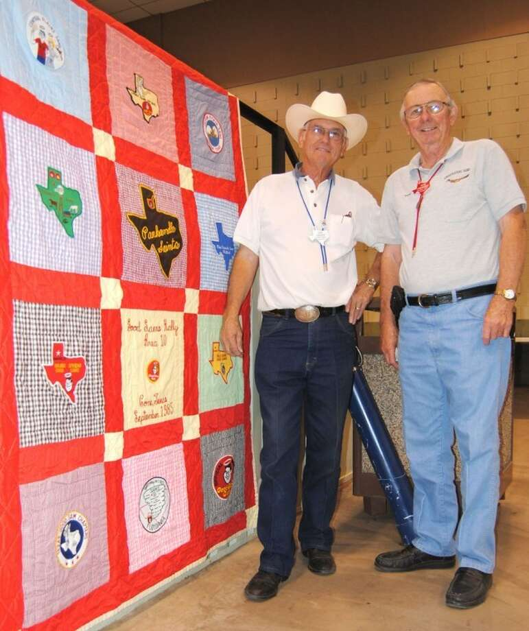 Jim Odom (left) of Plainview and Tom Etheredge of Childress look over a quilt from a 1985 Good Sam rally in Cone. On loan from the Texas Good Sam Museum, the quilt is one of many displays at the Area 10 mini-rally that continues through Sunday morning at the Ollie Liner Center. Approximately 50 RV rigs and as many as 200 participants are expected. Photo: Doug McDonough/Plainview Herald