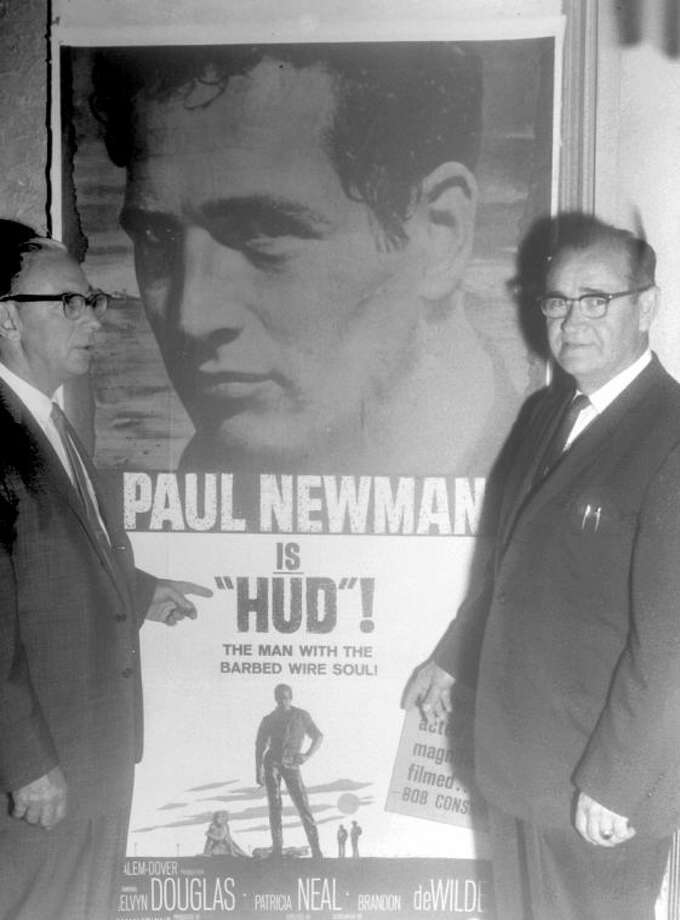 "Herald File PhotoIn a photo published by the Herald on June 2, 1963, Price Holland (left) and C.E. McSwain, partners in the operation of Plain view's five movie theaters, stand before a poster advertising ""Hud,"" starring Paul Newman. The movie was being shown at the Granada. Other local theaters were the Fair, Texas (Spanish), Twin-Vue Drive-In and Sunset Drive-In."
