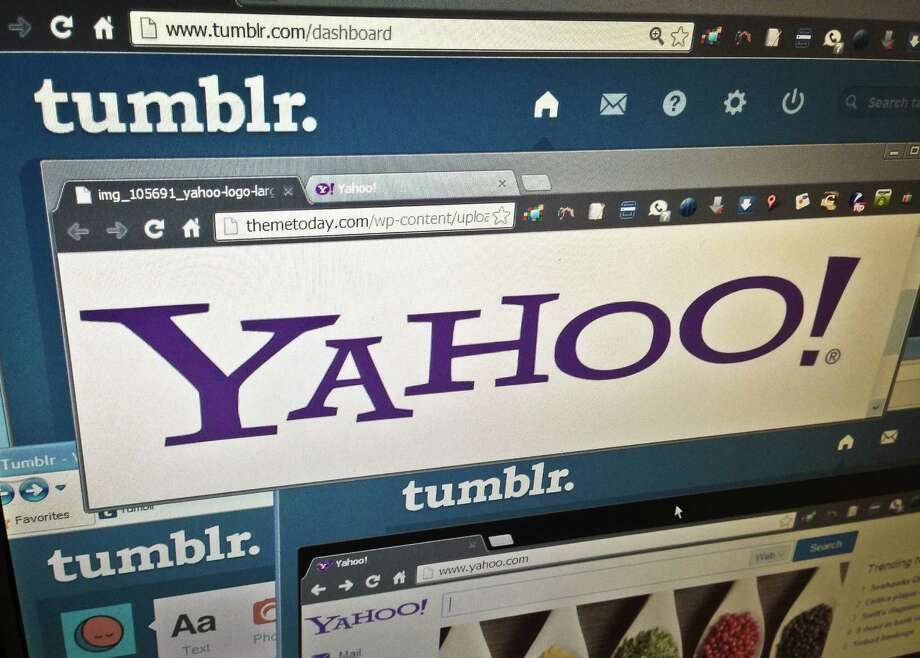 FILE - In this May 20, 2013, file photo, the web pages of Yahoo and Tumblr are displayed on a computer screen in New York. On Monday, July 25, 2016, Verizon formally announced that it is buying Yahoo for $4.83 billion, marking the end of an era for a company that once defined the internet. Nothing will change immediately to Yahoo email accounts and other services, but neither Yahoo nor Verizon said much about the once-venerable brand's future once Verizon takes over. (AP Photo/Bebeto Matthews, File) Photo: Bebeto Matthews, STF / A2013
