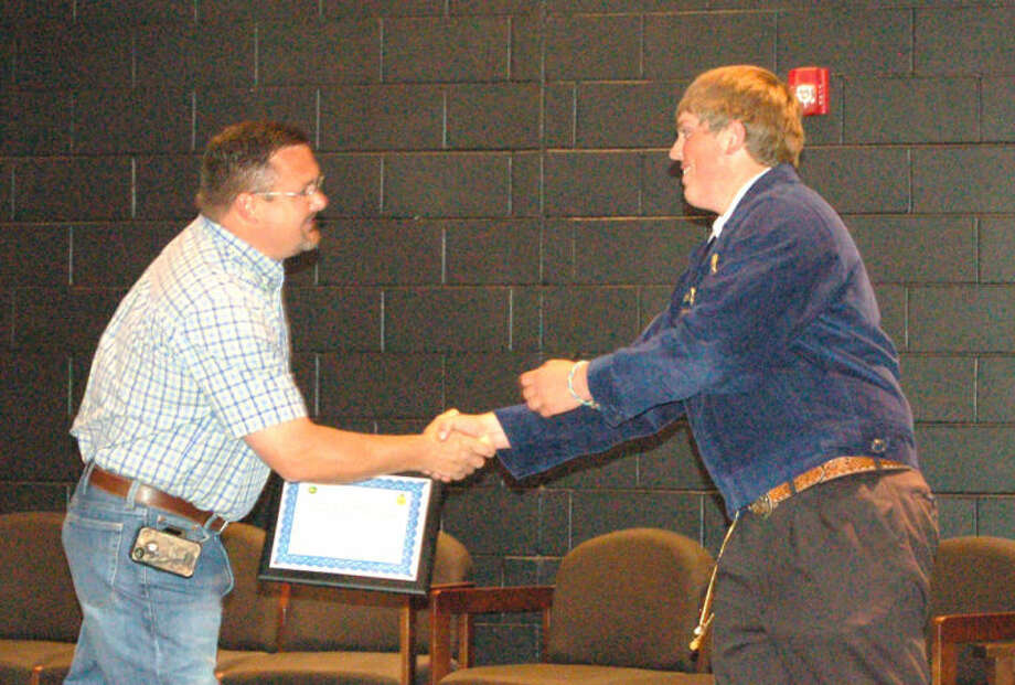 Courtesy PhotoHurst Farm Supply has awarded Plainview High senior Layton Schur with the 2013 John Deere/FFA Collegiate Scholarship. The son of Glenn and Dina Schur, he graduated Friday from Plainview High with a 3.84 grade point average. Schur plans to use the $2,000 scholarship to attend Texas Tech University and major in agricultural economics. Hurst salesman Doug Ogle (left) presented Schur with the scholarship.