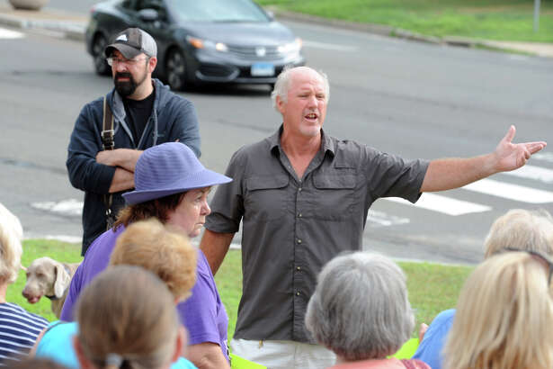 Ed Goodrich leads a protest in Stratford, Conn. July 25, 2016. Goodrich and others oppose the proposed demolition of Center School to make way for a new parking garage.