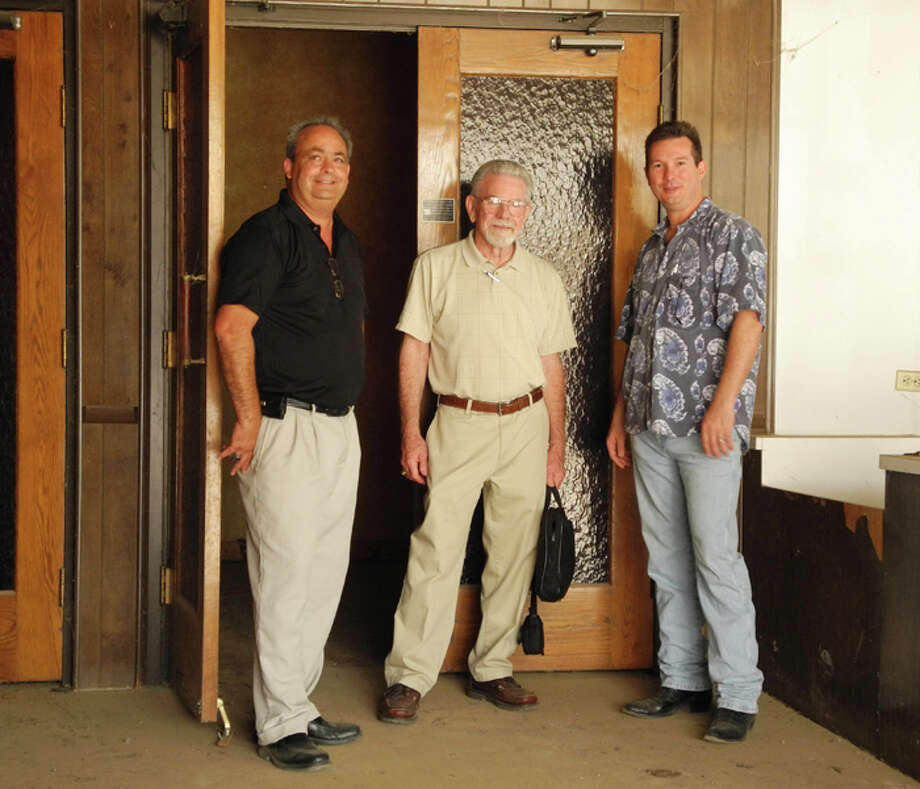 Lighting designer Craig Cheverier, architect Yancy Jones, and owner Darryl Holland stand at the entrance to the Granada Theater. Photo: Gail M. Williams | Plainview Herald