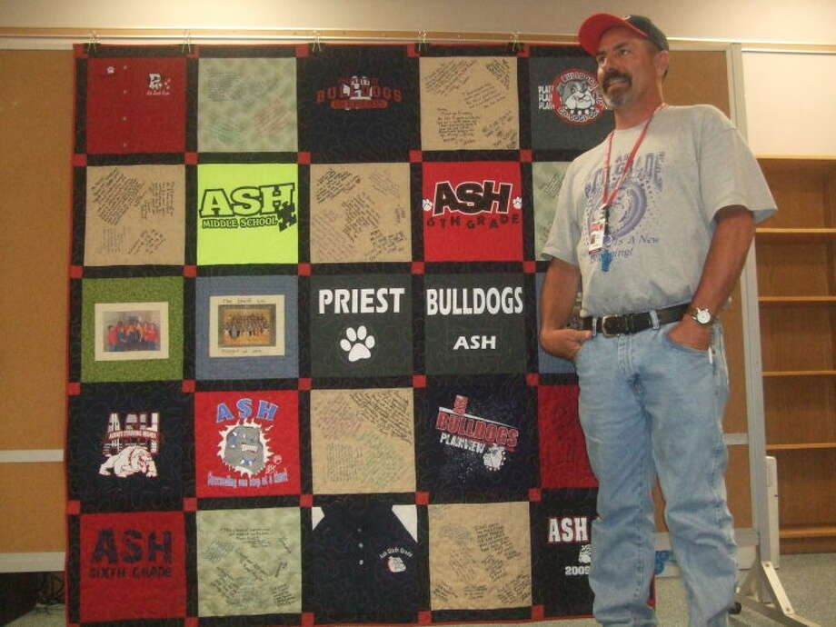 A quilt made of old Ash T-shirts by an Ash teacher was given to Principal Kelly Priest during the staff's farewell reception Thursday. Photo: Jessica Thornton/Plainview Herald