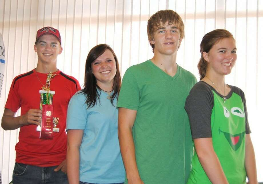 Doug McDonough/Plainview HeraldHale County senior 4-H team took first place in its division at the District 4-H Rifle Contest on April 21 at South Plains College in Levelland. Team members include Kalen Riley (left), Shelby Maresca, Max Gerber and Heather Bozeman. Individually, Riley was second place high individual, third place prone, second place standing and second place kneeling. Gerber took third place kneeling.