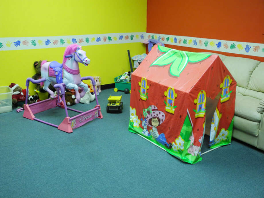 Children can play in the playroom during meetings. A window allows adults to look in on them. Photo: Gail M. Williams | Plainview Herald