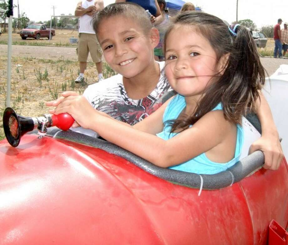 Adam Rios and his sister, Gabby Salazar, prepare to ride a train at Saturday's barrio reunion, held in conjunction with Cinco de Mayo. (See this week's Our People for more photos.)
