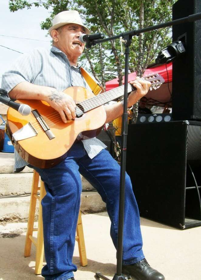 Kevin Lewis/Plainview HeraldAlfred Ramos Sr. sings a song he wrote about the barrio, where he moved in 1945, at Saturday's reunion. (See this week's Our People for more photos.)