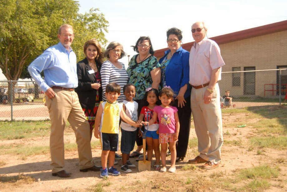 Wee Care Child Center broke ground for an all-natural playground that will be erected at the day care thanks to a grant awarded by the Plainview Area Endowment foundation. Wee Care kids (front left) Ian Garza, Jae'breon Wideman, Jazzlyn Urritua and Jazzl'yn Gill broke ground with Endowment board members (back from left) Willis McCutcheon, Frances Barrera, Corky Terrell, Wee Care Director Angel Morren, Tami Swoboda, and Endowment Chairman John Tye. Photo: Homer Marquez/Plainview Herald
