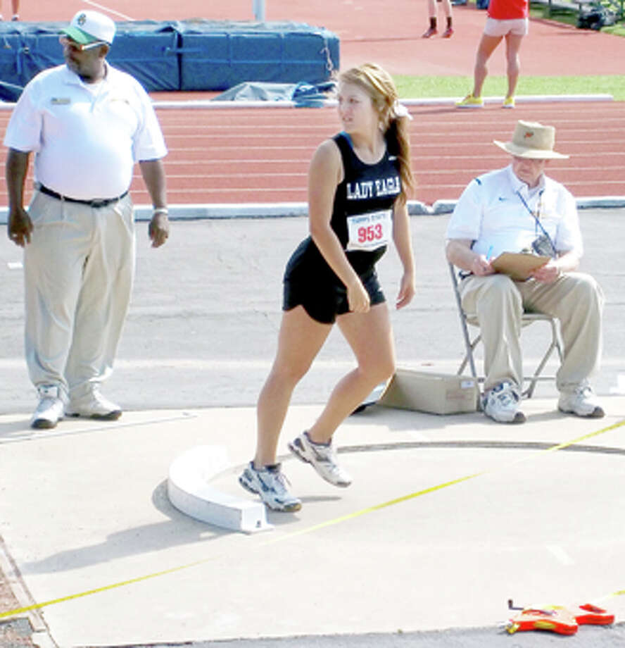 Plainview Christian's Madison Ortega watches her throw in the shot put at last weekend's TAPPS state track and field meet in Waco. Ortega finished in fourth place. Teammate Brittany Bradley was second in the discus while David Landtroop finished fifth in the 3,200 meters and sixth in the 1,600.
