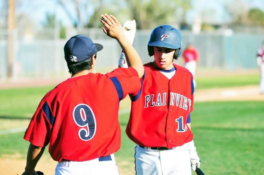 Plainview baseball coach Hector Limon Jr. is counting on Jordan Vera (left) and J.J. Perez to provide leadership on and off the field next season for the Bulldogs. Photo: Kevin Lewis/Plainview Herald