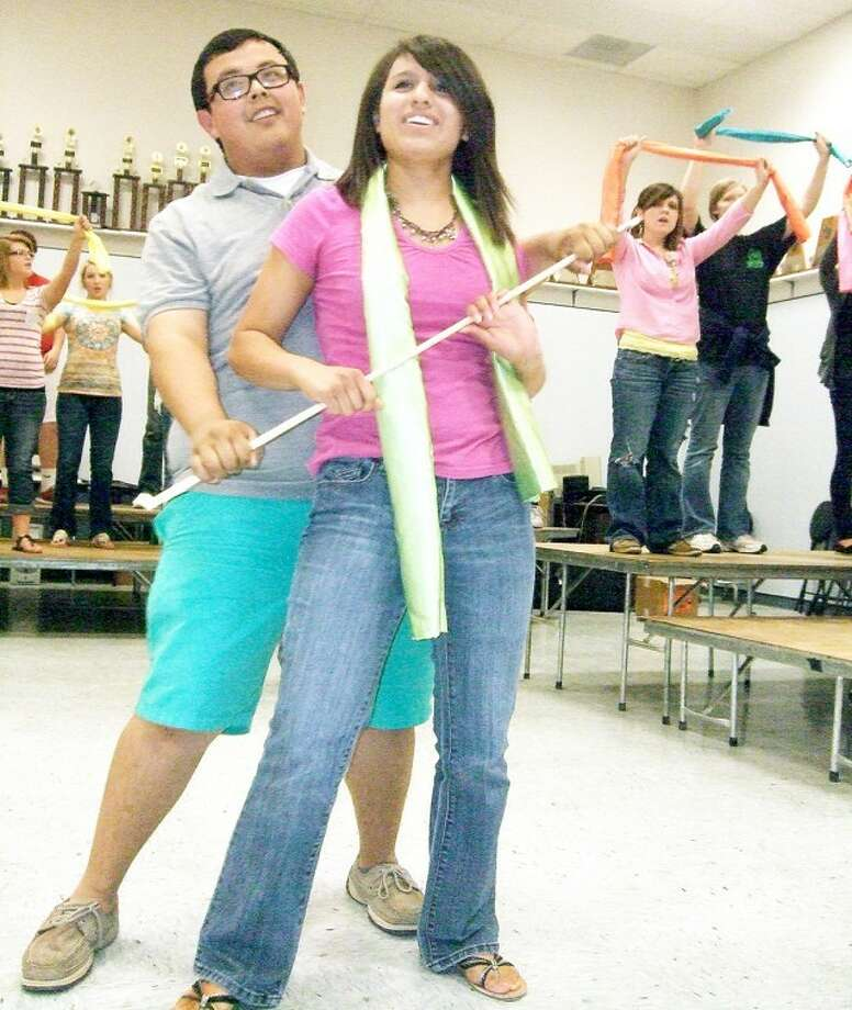 Kevin Lewis/Plainview HeraldPlainview High School senior A cappella Choir members Aaron Alcozer and Desiree Villarreal, who is valedictorian of the graduating class, rehearse a number for the 37th annual Red, White & Blue Revue, scheduled for 7:30 p.m. Thursday-Saturday in the PHS auditorium. Tickets to the event featuring songs and skits are $6 for adults and $4 for students. Elementary students will be admitted free with a parent on Thursday. Friday's show will be preceded by a brisket dinner, hosted by the PHS cheerleaders, from 5-7 p.m. in the cafeteria. Advance tickets, available from PHS cheerleaders, are $8. Tickets at the door are $10.