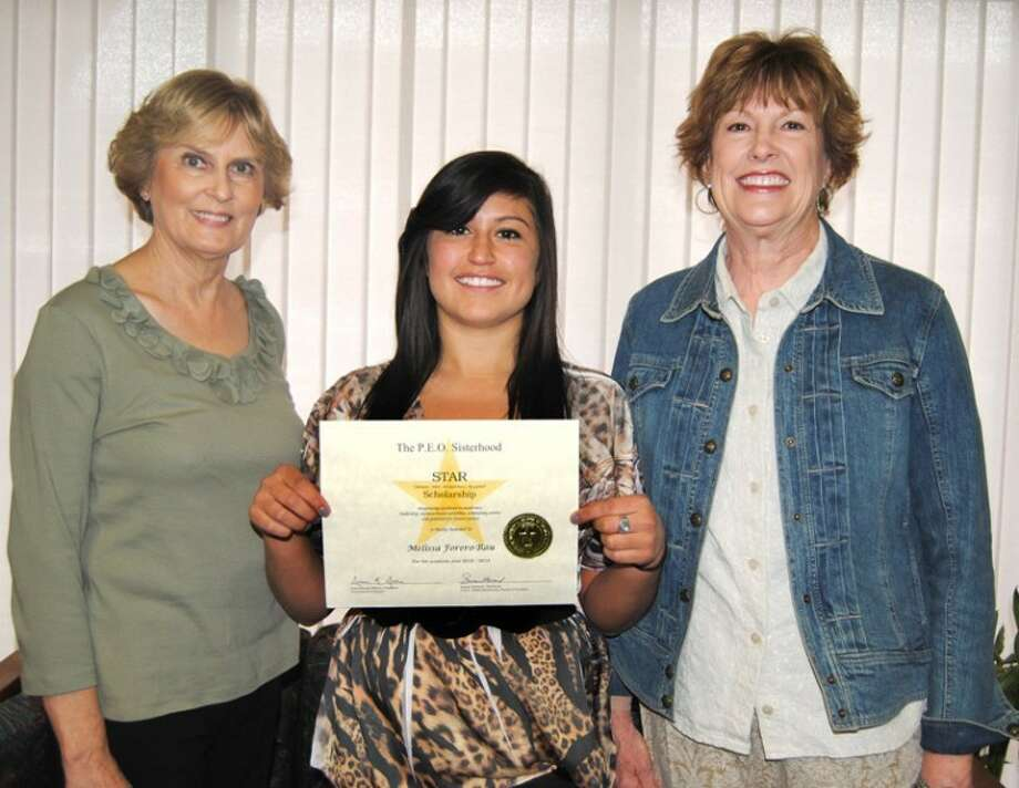 Doug McDonough/Plainview HeraldJane Lewellen (left) and Erin Martin (right), from CZ Chapter of P.E.O. Sisterhood present that organization's STAR Scholarship to Plainview High School senior Melissa Rau. The $2,500 national scholarship is awarded based on excellence in leadership, extracurricular activities, community service, academics and potential for success. Rau is the daughter of Janet Rau and plans to study social work at the University of Texas at Austin.
