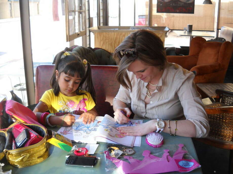 Little Sister Isabel and Big Sister Liz spend some time coloring during their one-on-one time in association with Plainview's Big Brothers Big Sisters mentoring program. Photo: Courtesy Photo