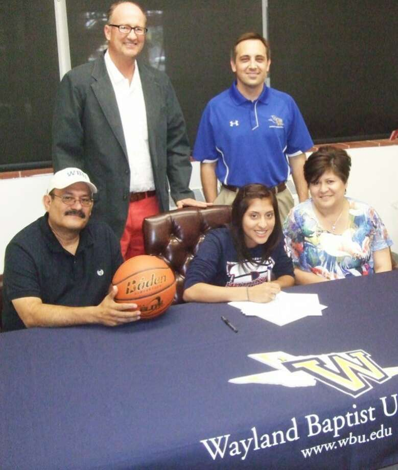 Plainview Lady Bulldog Laura Castillo on Thursday signed a scholarship agreement to play basketball for the Wayland Baptist Flying Queens. Castillo, a four-year all-district and two-time all-state honoree, is flanked by her parents, Liopaldo and Norma Martinez. Also shown are PHS coach Danny Wrenn and Queens coach Tory Bryant. Photo: Kevin Lewis/Plainview Herald