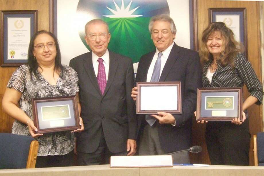 Jessica Thornton/Plainview HeraldOutgoing Mayor John C. Anderson (second from left) presented keys to the city at Tuesday's city council meeting to City Secretary Belinda Hinojosa (left), City Manager Greg Ingham and City Attorney Leslie Spear Pearce in recognition of their work while Anderson served as mayor.