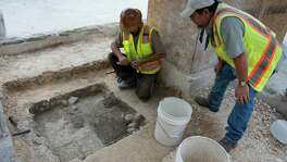 Archaeologists conducting investigative digs in Alamo Plaza on Monday reported uncovering part of an adobe wall, a link to the Spanish colonial period, in the southwest corner of the plaza.