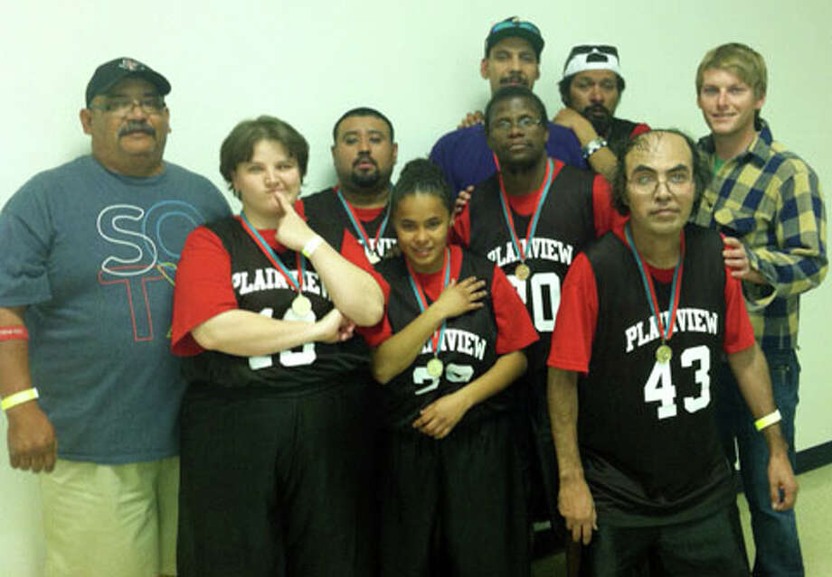 Coach Johnny Arjona (left), Amber Till, Abraham Martinez, Polly Gomez, Danny Potts, Donnie Matsler, Michael Bosquez, Jessie Tumbunga and Coach Brian Chadwick. Arjona has been coaching Special Olympics teams for 24 years. Photo: Courtesy Photo