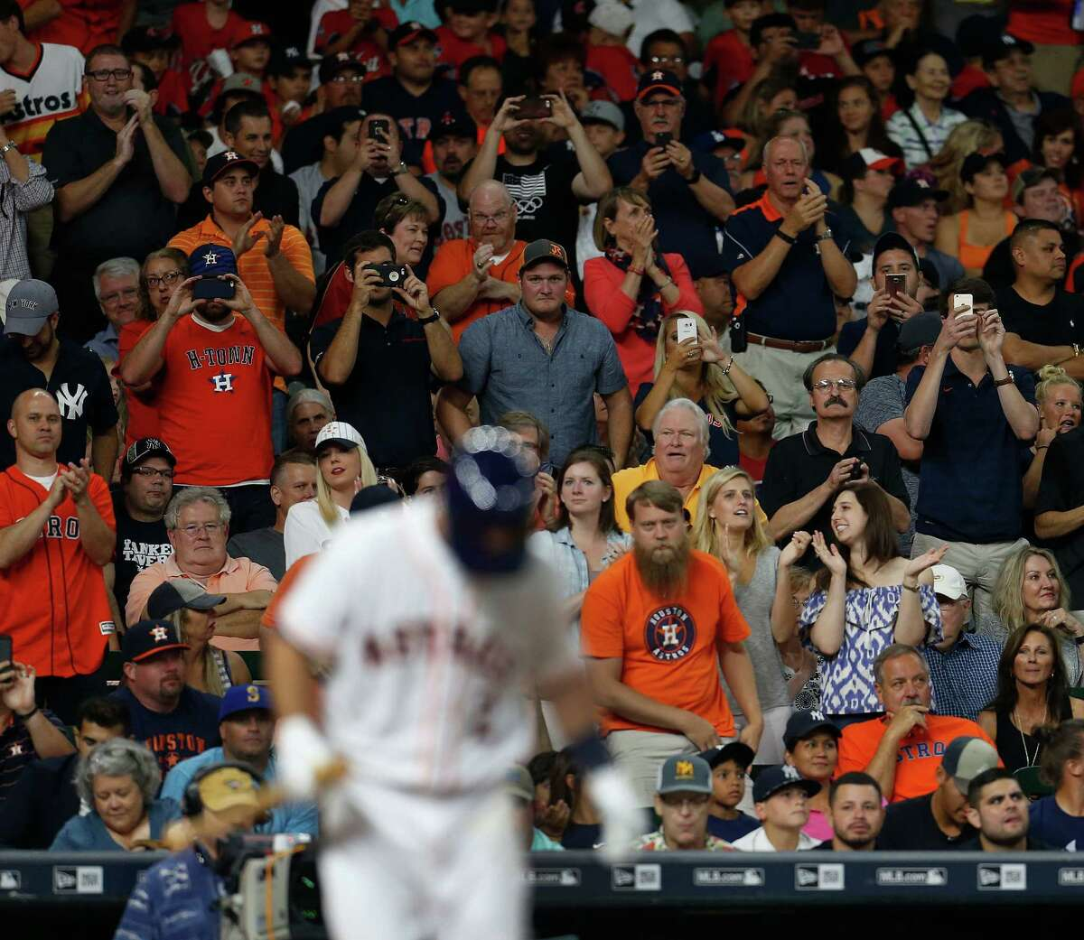 Fans stand and cheer as Houston Astros third baseman Alex Bregman (2) takes his first Major League at bat during the second inning of an MLB game at Minute Maid Park, Monday, July 25, 2016, in Houston.