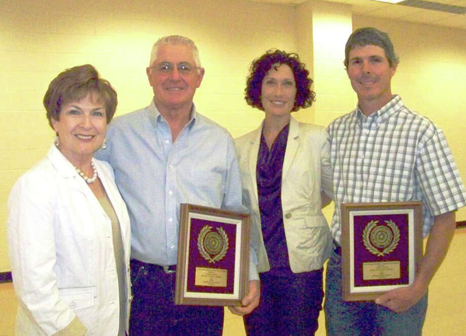 Courtesy PhotoSherry (left) and Butch Harrell and Christi and Michael Harrell, representing Harrell Farms of Hale Center, were recognized Tuesday for outstanding contributions to the Texas Soil and Water Conservation Program.