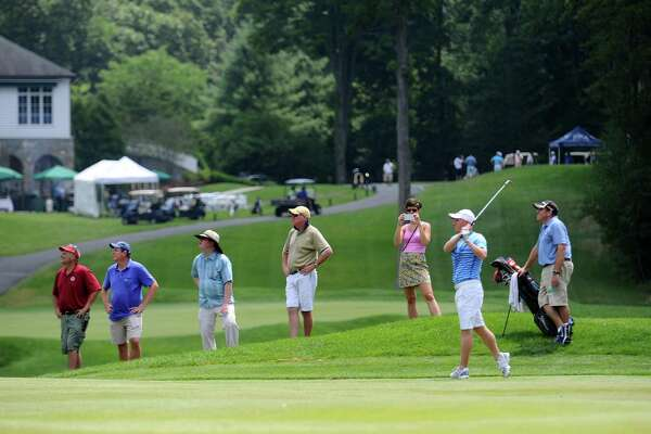 John Dailey, of H. Smith Richardson Golf Course in Fairfield, Conn., hits a shot off the fairway in front of a crowd during day 1 of the Connecticut Open at the Woodway Country Club in Darien, Conn. on Monday, July 25, 2016.