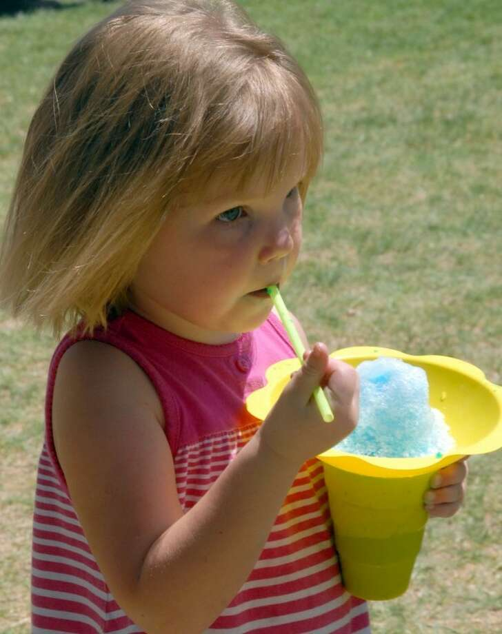 Four-year-old Kaydence Coleman eats a bubblegum snow cone during Saturday's Swisher County Picnic in Tulia. She is the daughter of Randy and Shannah Coleman. Photo: Richard Porter/Plainview Herald