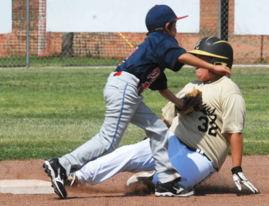 Plainview second baseman Jeremy Castillo tags out an Andrews runner in the second inning Saturday afternoon. The play occurred in an opening-round game of the Cal Ripken 12-year-old Major Division 60-foot state tournament at Wilhelm Field in Plainview. The local team lost to Andrews, but came back to defeat Littlefield Saturday night in the double-elimination tourney. However, they lost a close 10-8 decision to Muleshoe Sunday and were eliminated from the event. Photo: Skip Leon/Plainview Herald