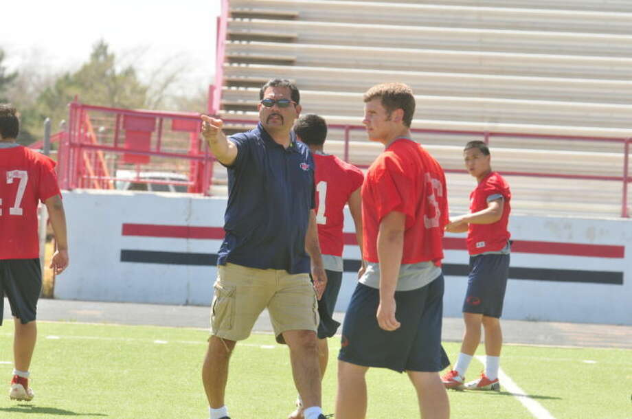 Former Plainview High School head football coach Marcos Hinojos (left), shown directing a spring practice, has accepted a job coaching outside linebackers at Wichita Falls Rider. Photo: Skip Leon/Plainview Herald