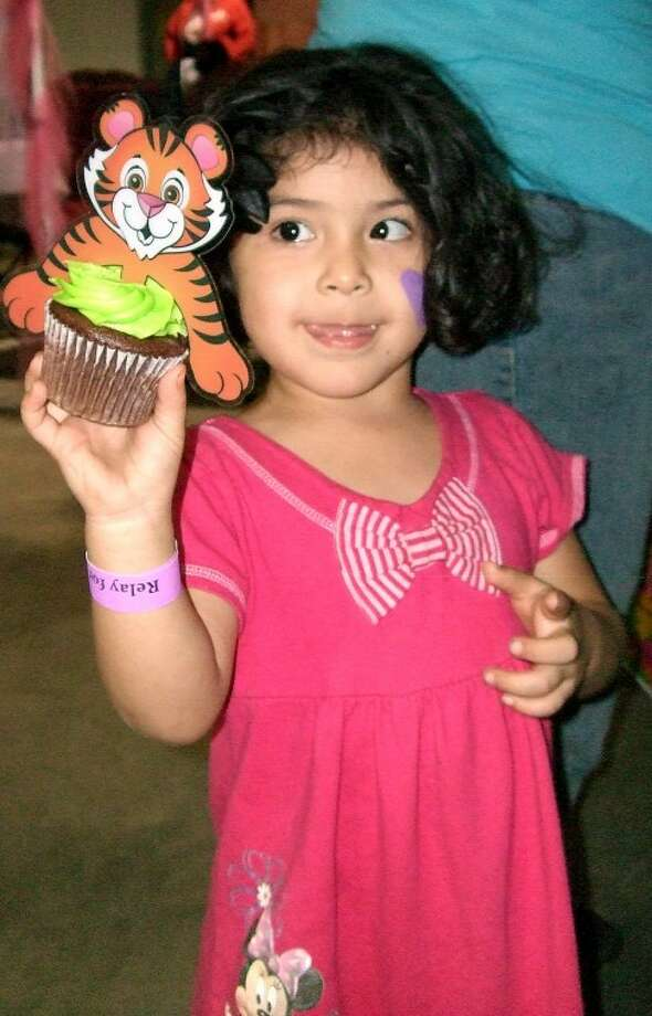Alyni Navarrete, 3-year-old daughter of John and Adriana Navarrete of Plainview, shows off the cupcake she bought at Friday night's Relay For Life. The annual fundraiser for the American Cancer Society drew hundreds of people to the Ollie Liner Center for food, fun and remembrances of those affected by cancer. (See related video.)