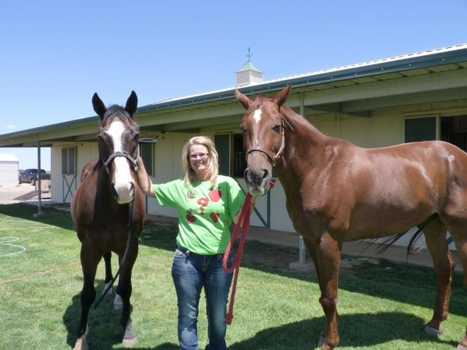 Bernadette Mulliken is shown with two of her retired horses, Tom and Fairplay, at their barn near Vista Grande Dairy just south of the city on FM 400.