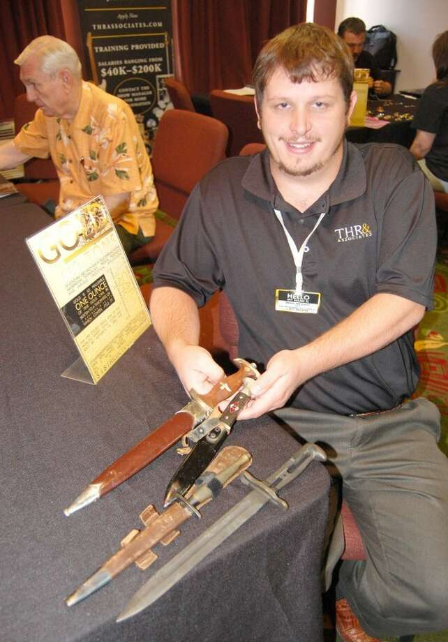 Doug McDonough/Plainview HeraldA set of four World War II-era knives, including a Nazi youth knife, a Nazi-emblazed dagger and a British Services blade, were among items purchased Tuesday during the opening day of the Ohio Valley Gold & Silver Refinery road show, according to Brent Prescott, field manager. The local owner received $280 for his collection. Prescott's three-member team will be at the Holiday Inn Express through Saturday, appraising and making offers on precious metals, jewelry, antiques and collectibles.