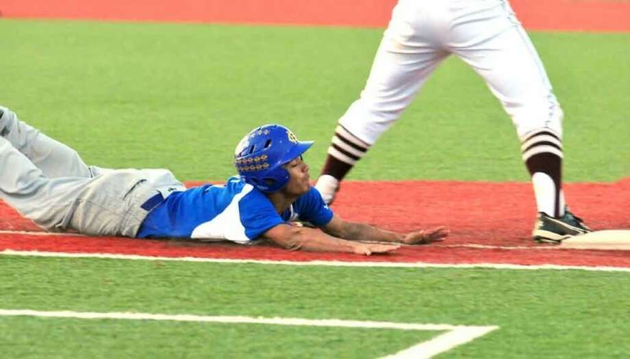 Hale Center's Mario Levya dives into first base during the Owls' area round playoff game against Seymour on Friday in Sundown. Photo: Summer Morgan/Plainview Herald