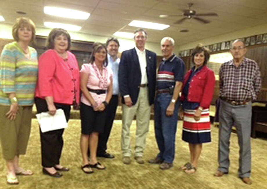 Courtesy PhotoThe Plainview Association of Realtors recently endorsed Jim Landtroop for re-election as state representative for District 88 and presented him with a check from the Texas Real Estate Political Action Committee (TREPAC) for his campaign. Present for the check presentation are Jeanine Brunson (left), Lynn Goddard, Codee Tye, David Kopp, Landtroop, Cary Eaves, Cyndy Walter and Buddy Brown.