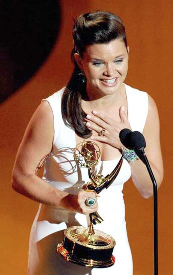 Courtesy PhotoHeather Tom accepts an Emmy Award foroutstanding supporting actress during Sunday night's Daytime EmmyAwards.