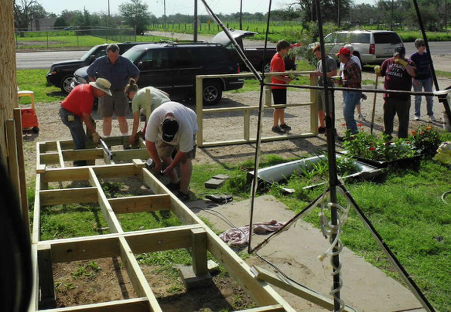 Members of Operation Serve with First United Methodist Church teamed up with Texas Ramp Project on Saturday to build a wheelchair ramp for a Plainview man who has difficulty walking. Photo: Gail M. Williams | Plainview Herald